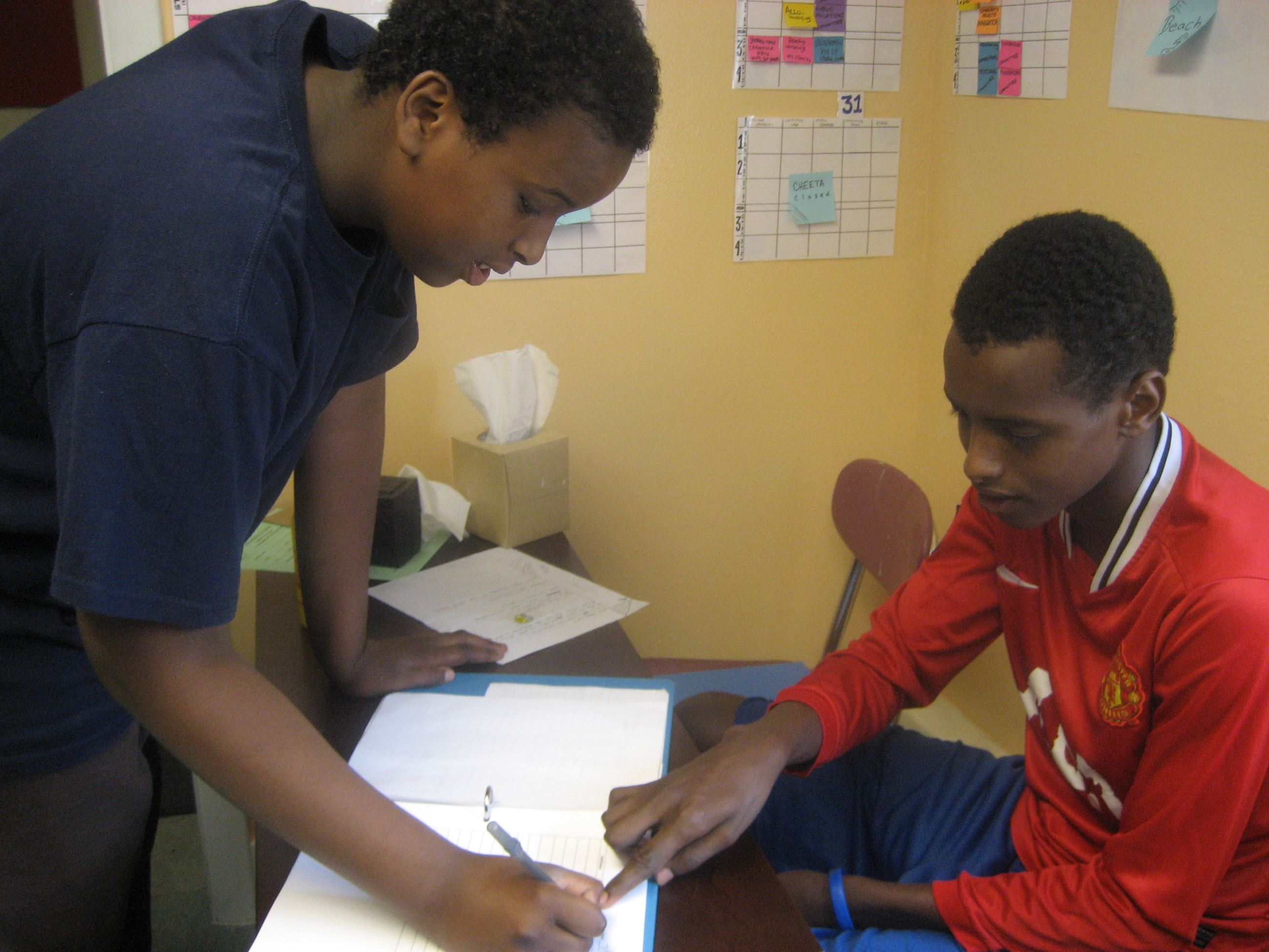 Two Students working together on a homework assignment in the Riverton Park Study Center